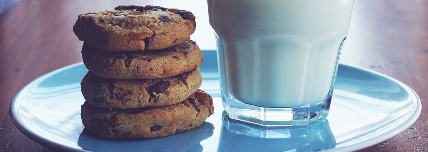 choc chip cookies with a glass of milk